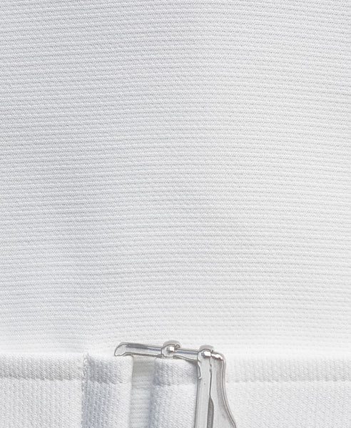 Bella London White boxy cropped top with buckle fastening and ¾ sleeves. Detail fabric photo.