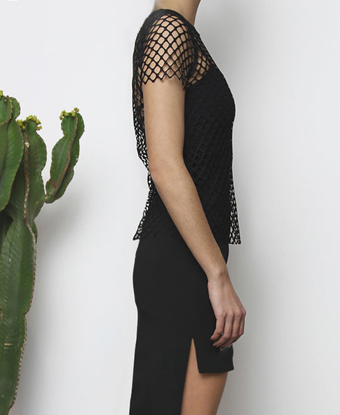 Bella London Andre black sheer net T-shirt with raw hem finish. Close up side view