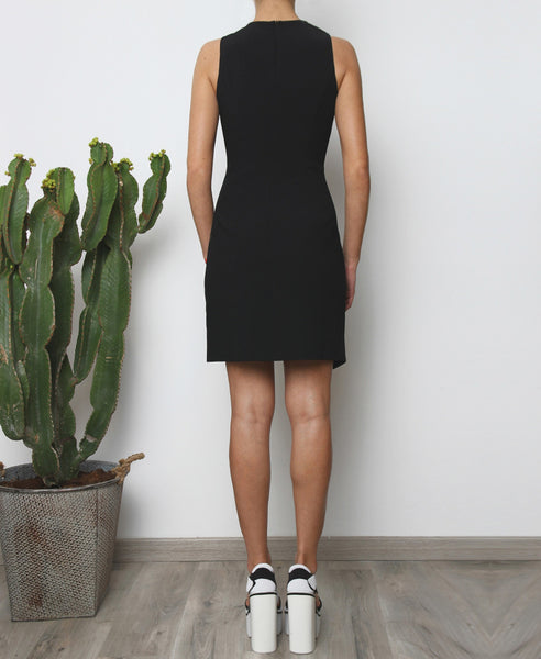 Bella London Augi Little Black Dress with asymmetric scalloped hem and a slight leg slit. Full length black photo.
