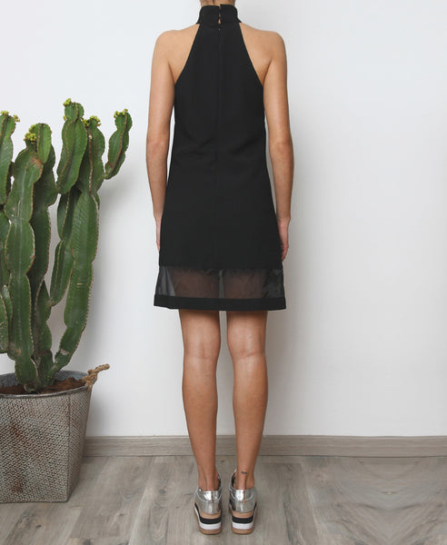 Bella London Black high neck shift dress with organza hem panel. Full length back photo.