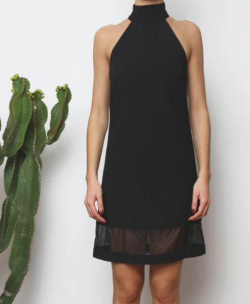 Bella London Black high neck shift dress with organza hem panel. Close up front photo.