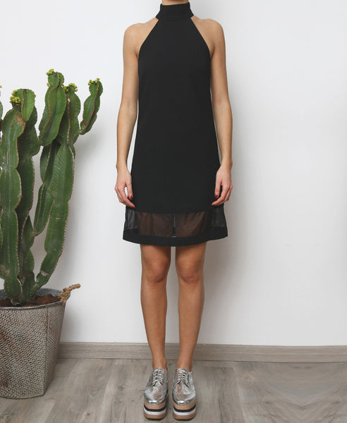 Bella London Black high neck shift dress with organza hem panel. Full length front photo.