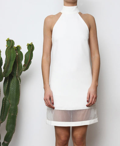 Bella London Fira White high neck shift dress with organza hem panel. Close up front photo.