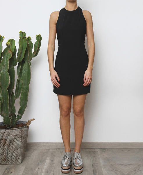 Bella London Multi-strap open back Little Black Dress with crew neckline and side invisible zip. Front full length photo.