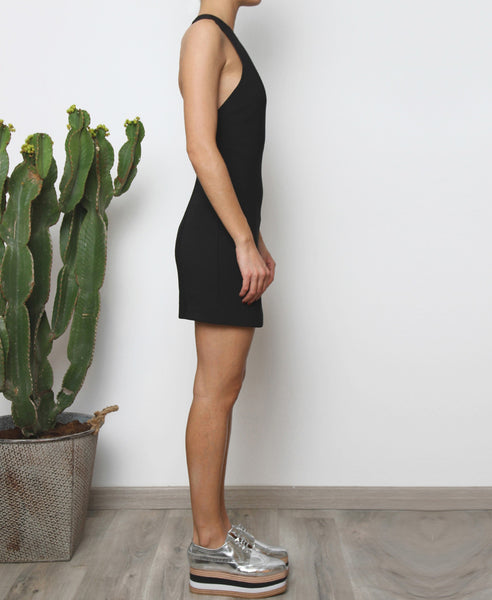 Bella London Multi-strap open back Little Black Dress with crew neckline and side invisible zip. Side full length photo.