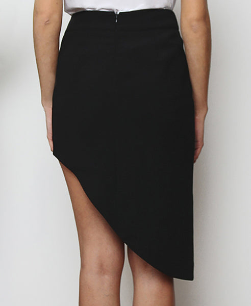 Bella London Black asymmetric skirt with waistband, tigh slit and back invisible zip. Back photo.