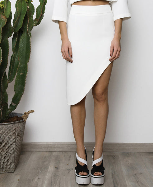 Bella London White asymmetric skirt with waistband, tigh slit and back invisible zip. Front photo.