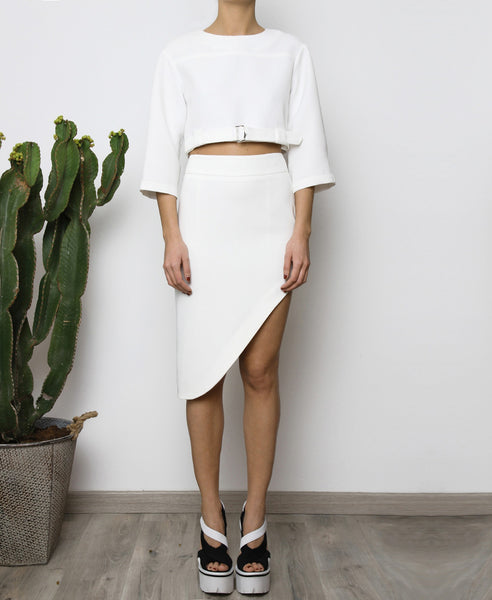 Bella London White asymmetric skirt with waistband, tigh slit and back invisible zip. Full length front photo.