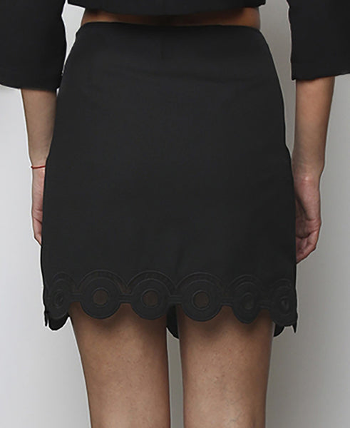 Bella London Black mini skirt with embroidered scalloped hem and organza inserts. Back photo.