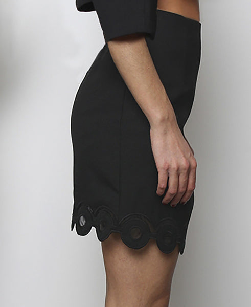 Bella London Black mini skirt with embroidered scalloped hem and organza inserts. Side photo.