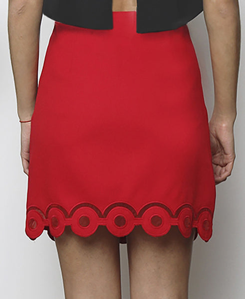 Bella London Red mini skirt with embroidered scalloped hem and organza inserts. Back photo.