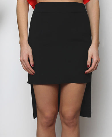 Bella London Black dipped hem pencil skirt with side slits and fold-over front waistband. Front close up photo.