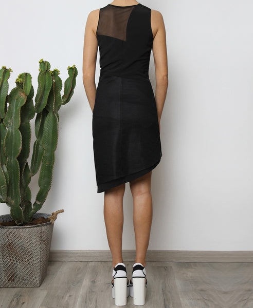 Bella London Panelled asymmetric black dress with mesh inserts. Back full length photo