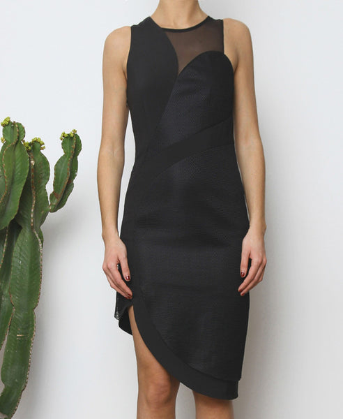 Bella London Panelled asymmetric black dress with mesh inserts. Front cropped photo.