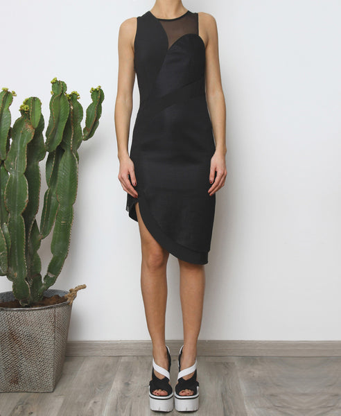 Bella London Panelled asymmetric black dress with mesh inserts. Front full length photo