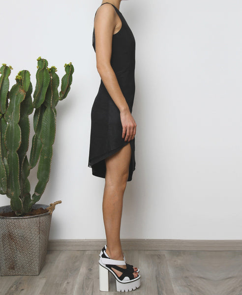 Bella London Panelled asymmetric black dress with mesh inserts. Side full length photo