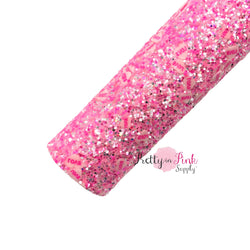 Rolled bubble pink chunky glitter sheet with light pink candy hearts with red writing LOVE.
