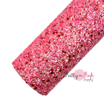 Rolled pink, red, and light pink chunky glitter sheet.
