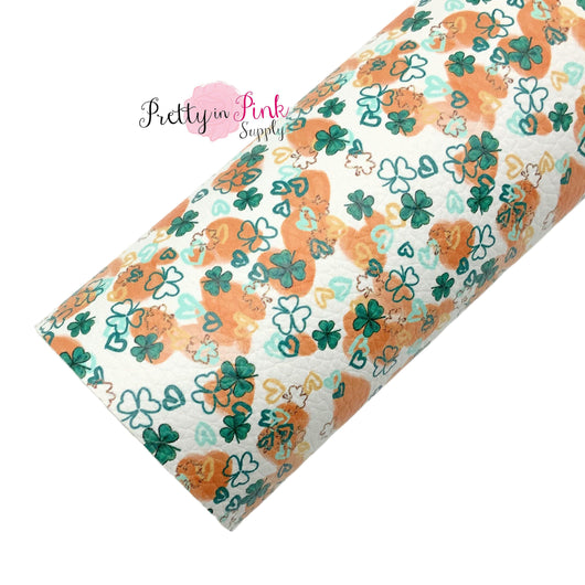 Rolled faux leather sheet with Orange smudges and green sharocks and hearts.