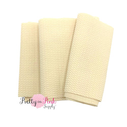 Folded over solid ivory color textured, stretch liverpool fabric strip.
