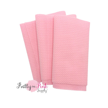 Folded over solid light pink color textured, stretch liverpool fabric strip.