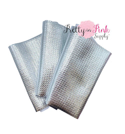 Folded Metallic Silver Liverpool Fabric Strip.