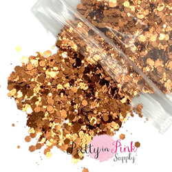 Spilling bag of copper metallic chunky glitter and fine glitter mix.