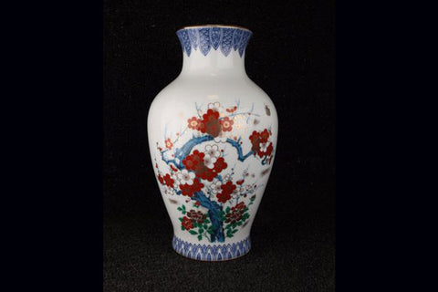 Vintage Japanese porcelain vase with flowering branch pattern in blue, red, green