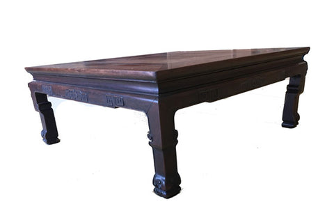 Square carved tea table in rich dark brown wood