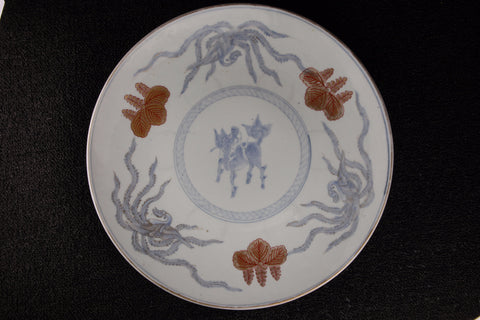 Vintage Imari orange and blue-grey porcelain plate with squid and seashell pattern