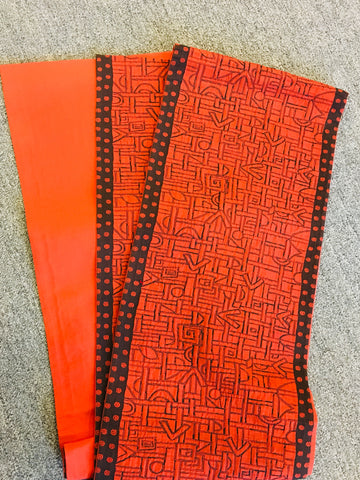 obi in burnt orange with abstract geometric pattern and edge trim - TLS Living