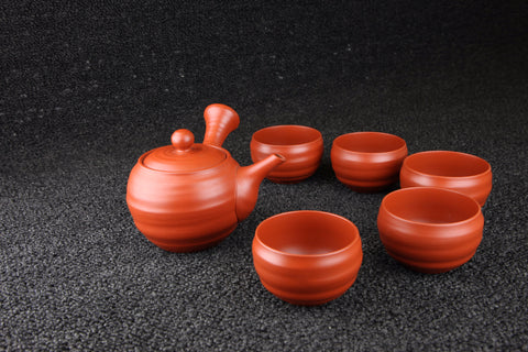 UNGLAZED REDDISH BROWN POTTERY TEA BOWLS