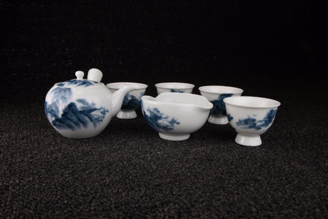 Vintage Arita-yaki porcelain tea set with blue and white landscape pattern