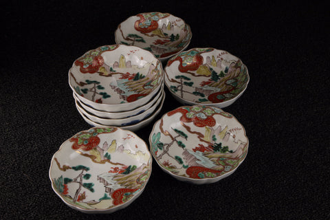 Imari vintage porcelain namasu dishes in red, blue, green, and brown with landscape pattern
