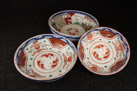 Imari vintage porcelain nesting bowls in red, blue, and green with botanic and plaid pattern