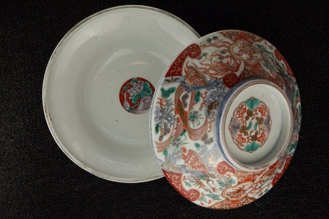 Imari vintage porcelain serving dish with lid in red, blue, green, and brown with pattern of quatrefoils and organic abstracts