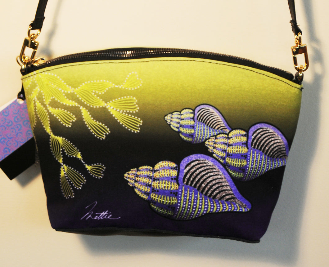 Lavendar Whelks cross-body bag.