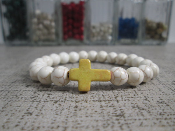 Sideway Cross Bead Bracelet Featuring a 8mm natural colored Howlite stone sideways cross