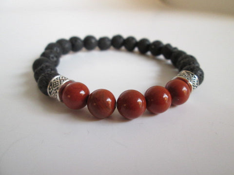 Stunning Bracelet Featuring Natural Red Jasper, Lava and Bali Beads on Elastic Bracelet. Sizing is approximately 7.5 inches on stretch cord, and is elastic. - SpuzzosDeals