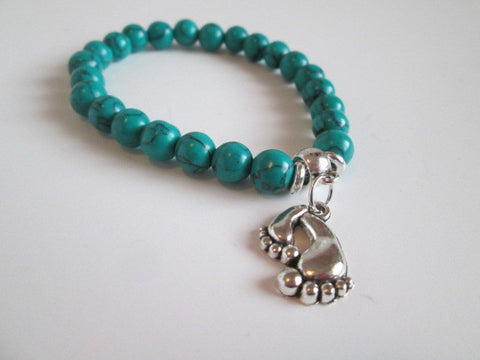 Beautiful Surfer Bracelet Turquoise Color Howlite Stone & Silver Tone Bare Feet Charm - SpuzzosDeals