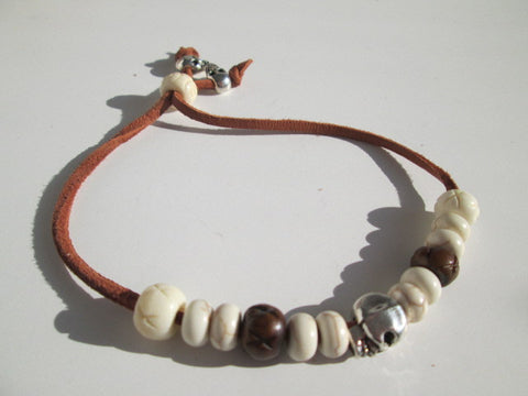 Surfer Bracelet featuring Leather a silver colored Skull, white howlite stone beads and silver beads - SpuzzosDeals