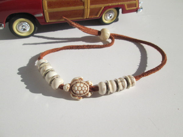 Leather Surfer Bracelet featuring a white turtle,  howlite stone and silver beads - SpuzzosDeals