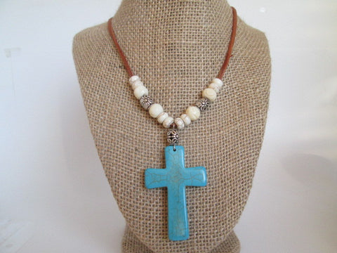 Stunning handmade Necklace featuring turquoise stone cross on leather cording - SpuzzosDeals