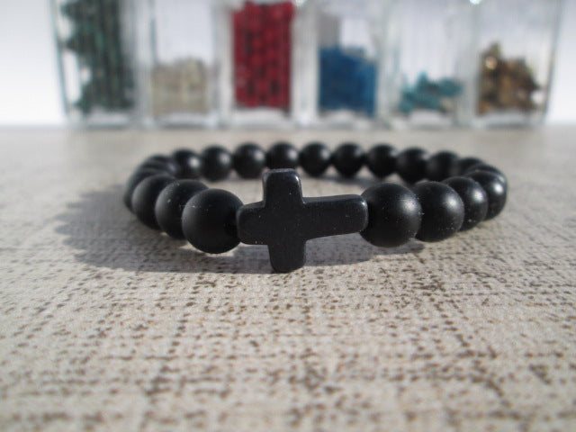 Sideways Cross Bead Bracelet Featuring a 8mm natural colored Howlite stone sideways cross