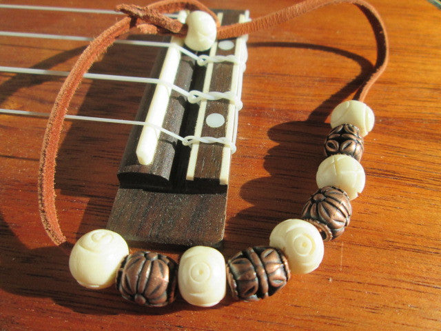 Cool Bracelet Featuring Leather, Bone and Bronze Beads - SpuzzosDeals