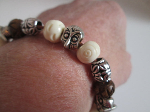 Handsome leather bracelet featuring wooden beads - SpuzzosDeals
