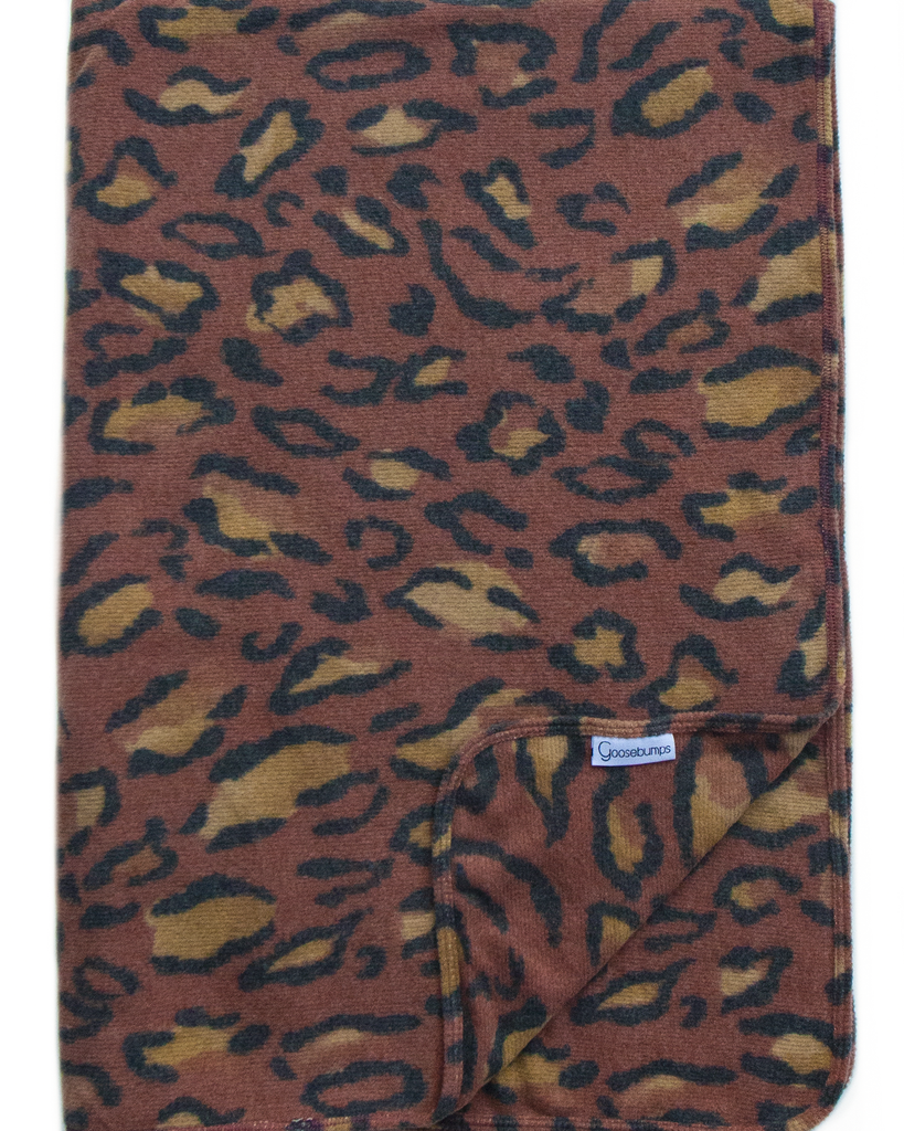snow leopard throw / rust