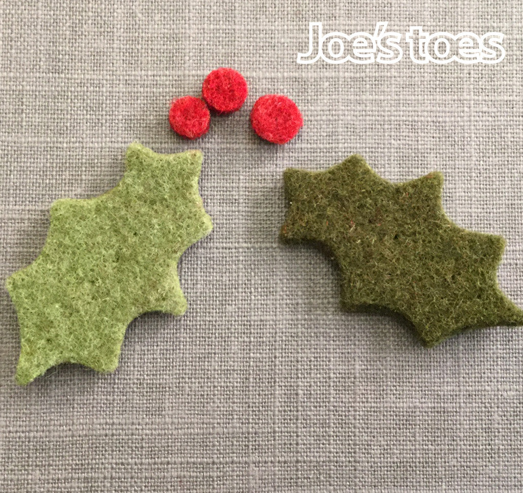 A pair of Joe's Toes Felt Holly Leaves and Berries