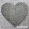 Joe's Toes dark grey heart shaped patch with stitch holes