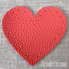 Joe's Toes red heart shaped patch with stitch holes